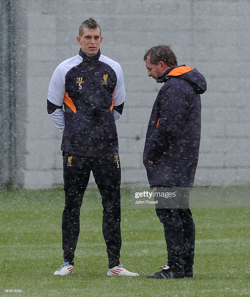 Brendan Rodgers manger of Liverpool talking with Daniel Agger in action during a training session at Melwood Training Ground on February 13, 2013 in Liverpool, England.