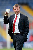 Brendan Rodgers of Liverpool inspects the pitch prior to the the Barclays Premier League match between Crystal Palace and Liverpool at Selhurst Park...