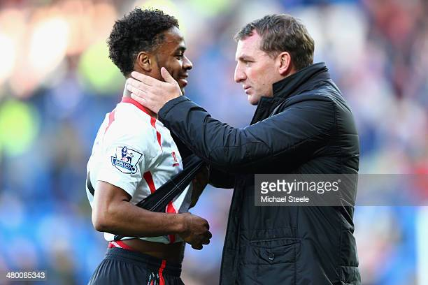 Brendan Rodgers the manager of Liverpool chats with Raheem Sterling after his side's 63 victory during the Barclays Premier League match between...