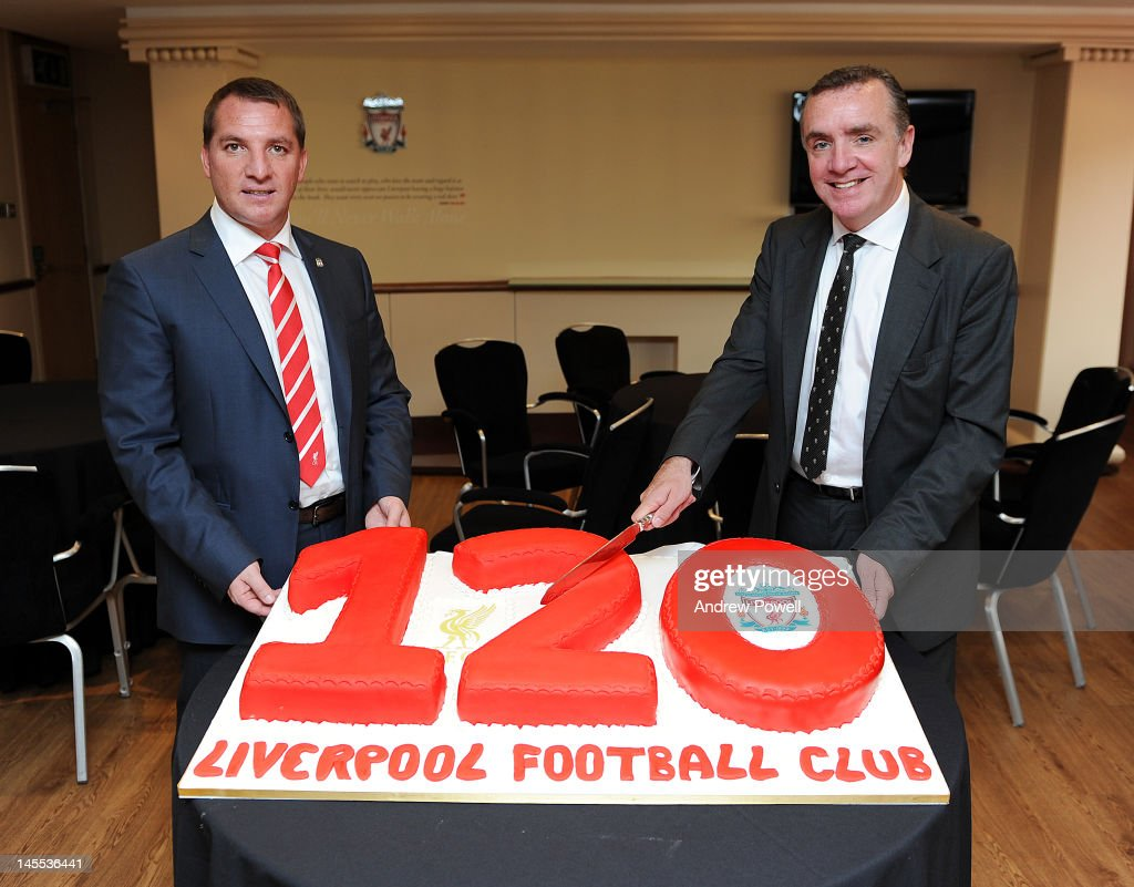 <a gi-track='captionPersonalityLinkClicked' href=/galleries/search?phrase=Brendan+Rodgers+-+Soccer+Manager&family=editorial&specificpeople=5446684 ng-click='$event.stopPropagation()'>Brendan Rodgers</a> the new Liverpool FC manager (L) and Ian Ayre, the managing director with a cake baked to celebrate the 120th Birthday of the club at Anfield on June 1, 2012 in Liverpool,England. On June 3rd 2012, LFC will be 120 years old, a date recognised as being that when Liverpool Football Club and Athletic Grounds Co Ltd was given a certificate from the Board of Trade allowing it to trade.