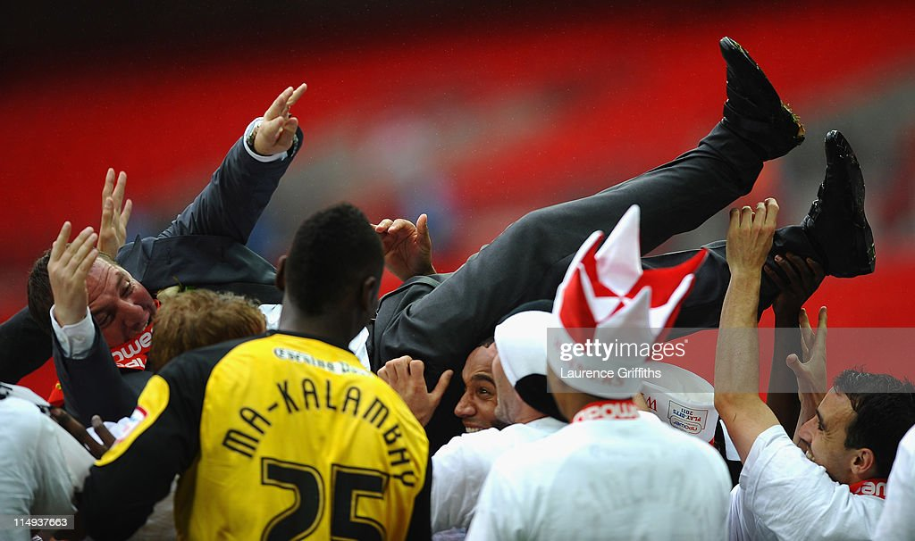 Brendan Rogers of Swansea City is thrown in the air by his players after victory in the npower Championship Playoff Final between Reading and Swansea City at Wembley Stadium on May 30, 2011 in London, England.