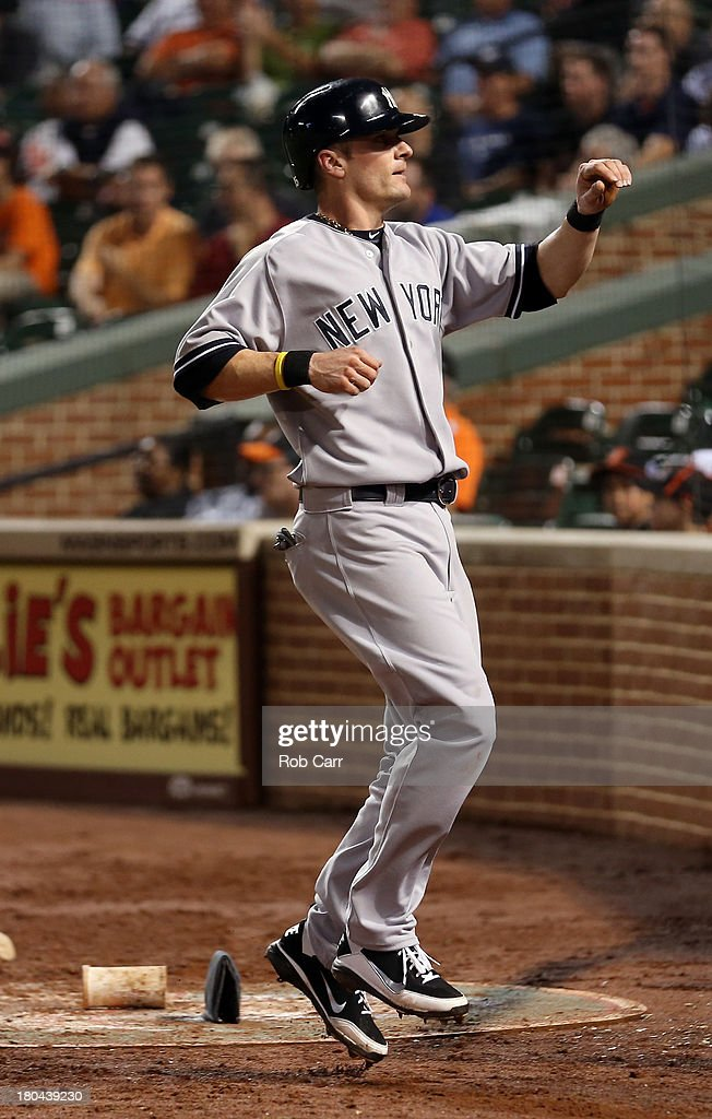 <a gi-track='captionPersonalityLinkClicked' href=/galleries/search?phrase=Brendan+Ryan&family=editorial&specificpeople=835643 ng-click='$event.stopPropagation()'>Brendan Ryan</a> #35 of the New York Yankees celebrates after scoring the go ahead run on a wild pitch by pitcher Jim Johnson #43 of the Baltimore Orioles (not pictured) during the ninth inning at Oriole Park at Camden Yards on September 12, 2013 in Baltimore, Maryland. The Yankees won 6-5.