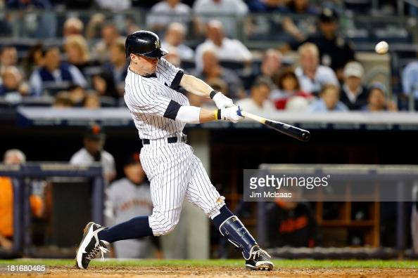 Brendan Ryan of the New York Yankees connects on a fifth inning base hit against the San Francisco Giants at Yankee Stadium on September 20 2013 in...