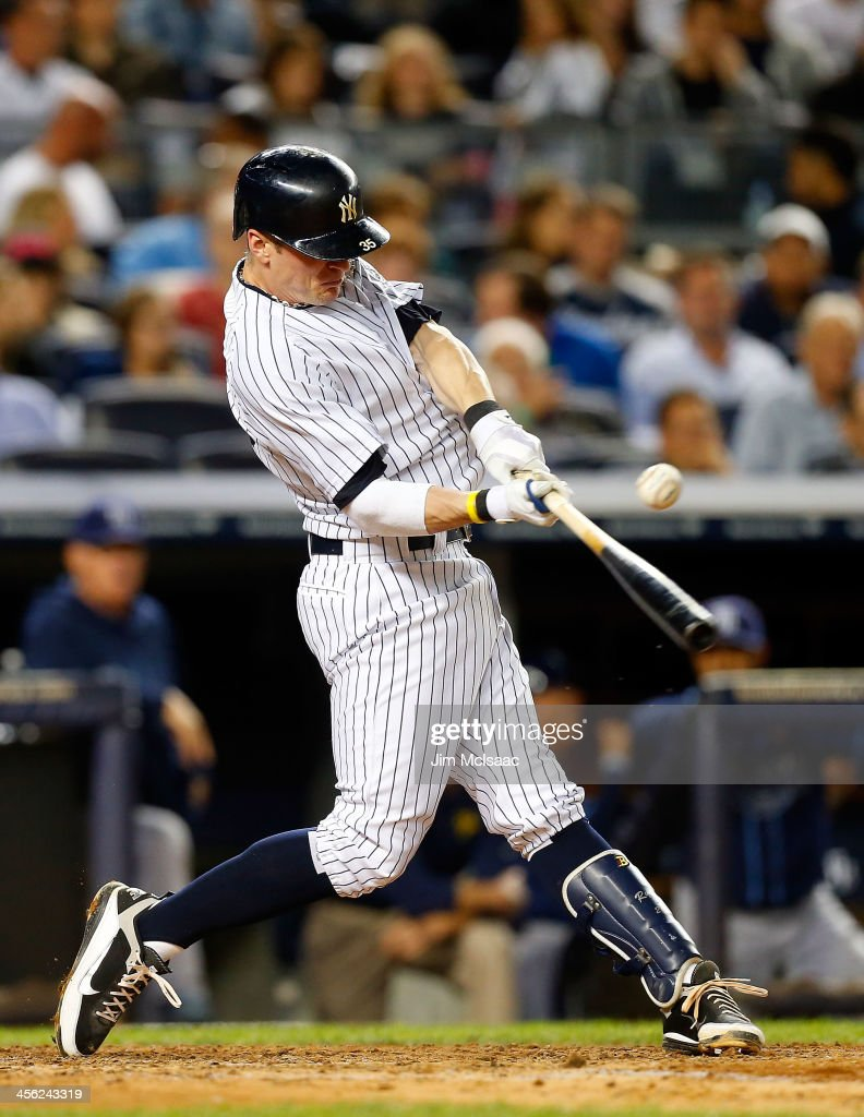 Brendan Ryan of the New York Yankees connectsw on a fourth inning base hit against the Tampa Bay Rays at Yankee Stadium on September 25 2013 in the...