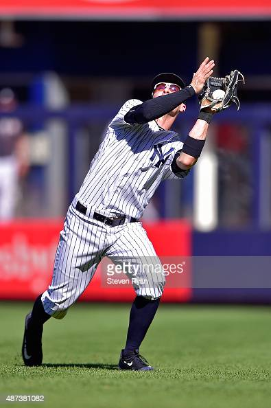 Brendan Ryan of the New York Yankees fields a fly ball in the seventh inning against the Tampa Bay Rays at Yankee Stadium on September 5 2015 in New...