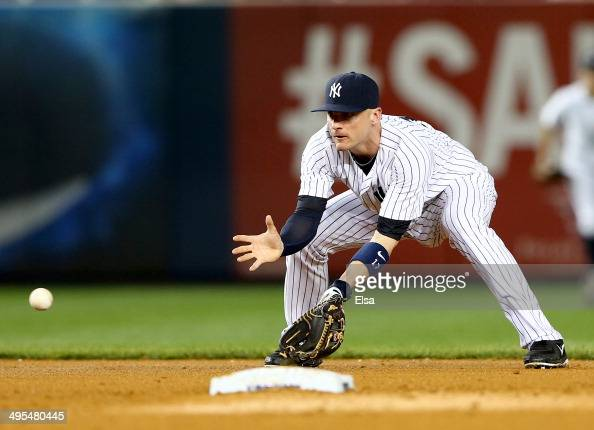 Brendan Ryan of the New York Yankees fields a hit in the fifth inning against the Oakland Athletics on June 3 2014 at Yankee Stadium in the Bronx...