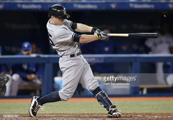 Brendan Ryan of the New York Yankees hits a double in the eighth inning during MLB game action against the Toronto Blue Jays on September 18 2013 at...