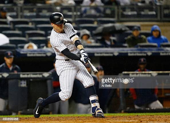 Brendan Ryan of the New York Yankees hits a single and drives in a run against the Boston Red Sox in the second inning during their game at Yankee...