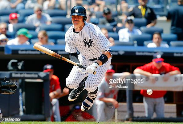 Brendan Ryan of the New York Yankees is hit by a pitch in the fifth inning against the Washington Nationals at Yankee Stadium on June 10 2015 in the...
