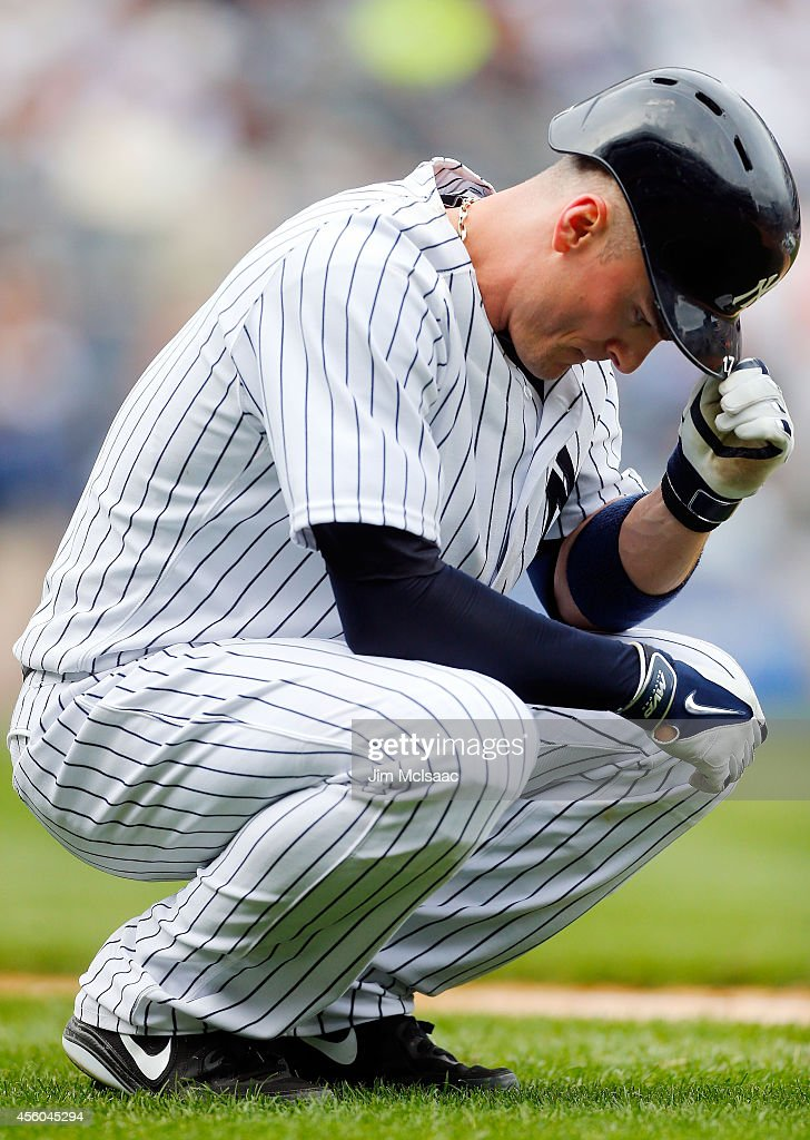Brendan Ryan of the New York Yankees reacts after flying out to end the seventh inning against the Baltimore Orioles at Yankee Stadium on September...