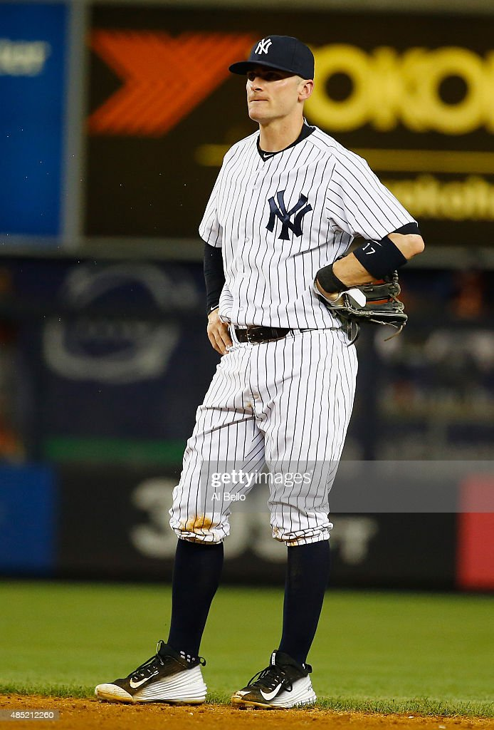 Brendan Ryan of the New York Yankees reacts after making an error against Jed Lowrie of the Houston Astros in the fifth inning during their game at...