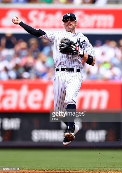 Brendan Ryan of the New York Yankees sends the ball to first for the out in the third inning against the Toronto Blue Jays on August 8 2015 at Yankee...
