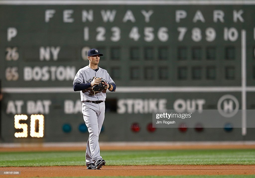 Brendan Ryan of the New York Yankees takes the short stop position in the first inning during a game against the Boston Red Sox at Fenway Park on...