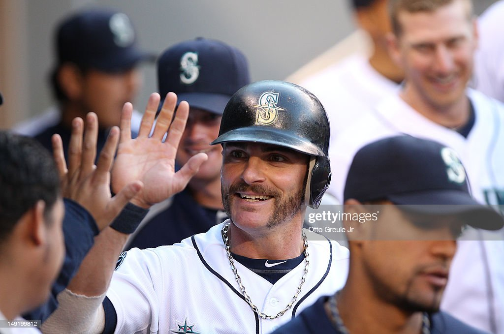 Brendan Ryan #26 of the Seattle Mariners celebrates after scoring on an RBI single by Jesus Montero against the New York Yankees at Safeco Field on July 24, 2012 in Seattle, Washington. The Mariners defeated the Yankees 4-2.