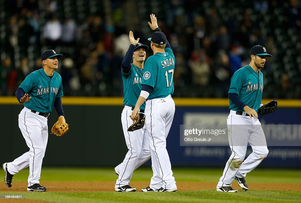 <a gi-track='captionPersonalityLinkClicked' href=/galleries/search?phrase=Brendan+Ryan&family=editorial&specificpeople=835643 ng-click='$event.stopPropagation()'>Brendan Ryan</a> #26 of the Seattle Mariners congratulates <a gi-track='captionPersonalityLinkClicked' href=/galleries/search?phrase=Justin+Smoak&family=editorial&specificpeople=2350583 ng-click='$event.stopPropagation()'>Justin Smoak</a> #17 after defeating the Texas Rangers 3-1 at Safeco Field on April 12, 2013 in Seattle, Washington.