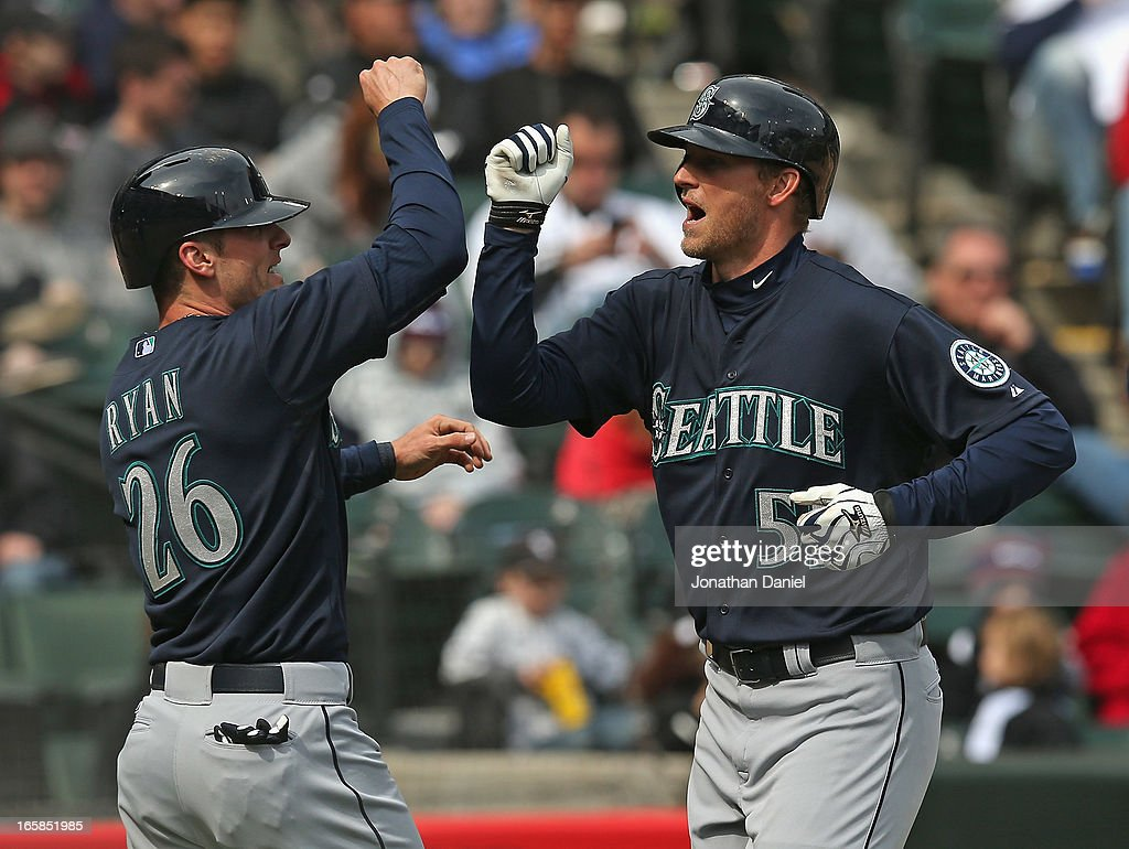 Brendan Ryan #26 of the Seattle Mariners congratulates teammate Michael Saunders #55 after Saunders hit a two-run home run in the 8th inning against the Chicago White Sox at U.S. Cellular Field on April 6, 2013 in Chicago, Illinois. The White Sox defeated the Mariners 4-3.