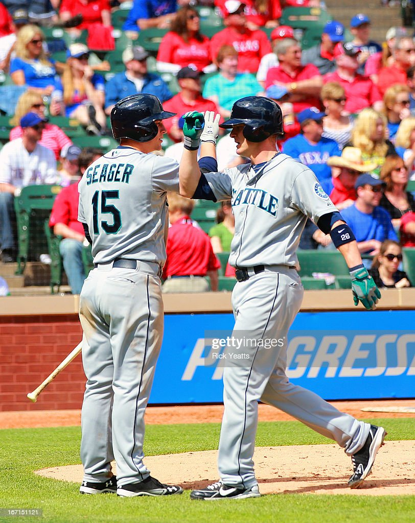 <a gi-track='captionPersonalityLinkClicked' href=/galleries/search?phrase=Brendan+Ryan&family=editorial&specificpeople=835643 ng-click='$event.stopPropagation()'>Brendan Ryan</a> #26 of the Seattle Mariners is congratulated by <a gi-track='captionPersonalityLinkClicked' href=/galleries/search?phrase=Kyle+Seager&family=editorial&specificpeople=7682389 ng-click='$event.stopPropagation()'>Kyle Seager</a> #15 for scoring on RBI double by Endy Chavez #9 at Rangers Ballpark in Arlington on April 21, 2013 in Arlington, Texas.