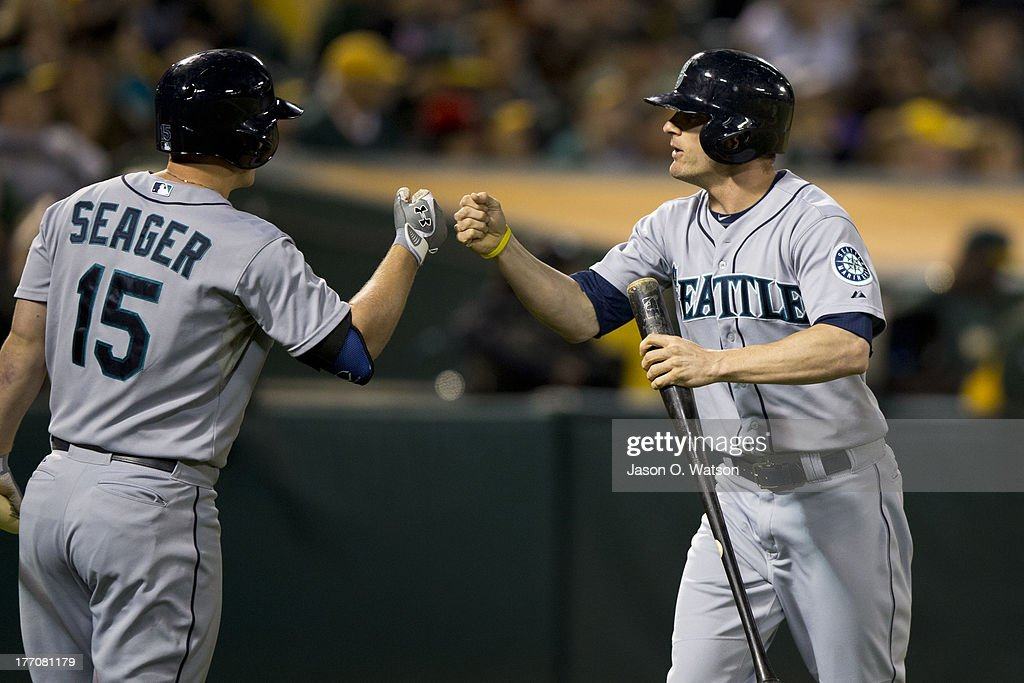 <a gi-track='captionPersonalityLinkClicked' href=/galleries/search?phrase=Brendan+Ryan&family=editorial&specificpeople=835643 ng-click='$event.stopPropagation()'>Brendan Ryan</a> #26 of the Seattle Mariners is congratulated by <a gi-track='captionPersonalityLinkClicked' href=/galleries/search?phrase=Kyle+Seager&family=editorial&specificpeople=7682389 ng-click='$event.stopPropagation()'>Kyle Seager</a> #15 after scoring a run against the Oakland Athletics during the eighth inning at O.co Coliseum on August 20, 2013 in Oakland, California.