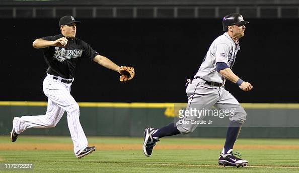 Brendan Ryan of the Seattle Mariners is run down by third baseman Greg Dobbs of the Florida Marlins in the seventh inning at Safeco Field on June 24...