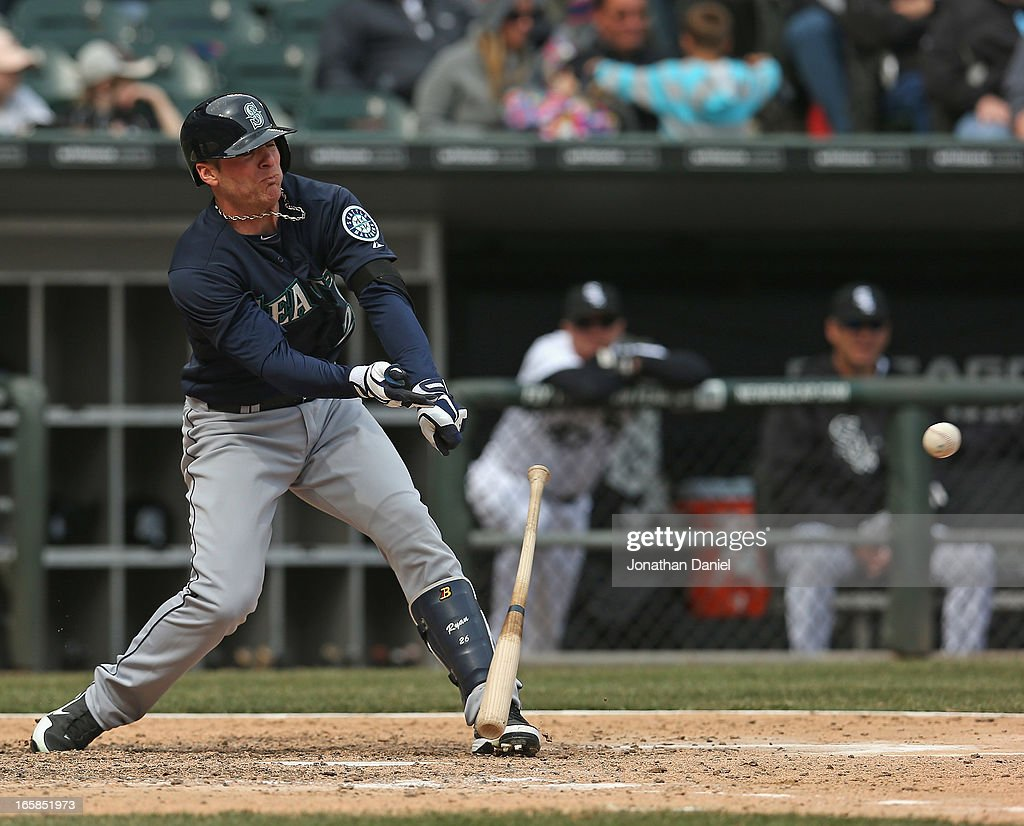Brendan Ryan #26 of the Seattle Mariners looses his bat as he hits a single in the 8th inning against the Chicago White Sox at U.S. Cellular Field on April 6, 2013 in Chicago, Illinois. The White Sox defeated the Mariners 4-3.