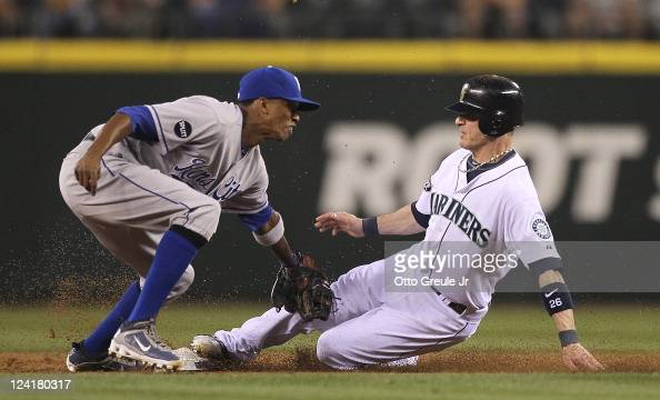 Brendan Ryan of the Seattle Mariners steals second base against shortstop Alcides Escobar of the Kansas City Royals at Safeco Field on September 8...