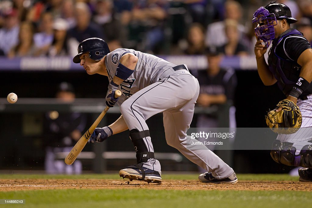 Brendan Ryan of the Seattle Mariners watches a bunt against the Colorado Rockies at Coors Field on May 18 2012 in Denver Colorado The Mariners...