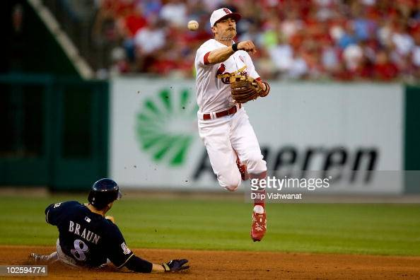 Brendan Ryan of the St Louis Cardinals turns a double play over Ryan Braun of the Milwaukee Brewers at Busch Stadium on July 2 2010 in St Louis...