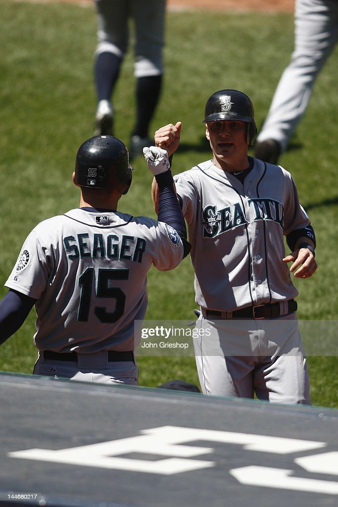 <a gi-track='captionPersonalityLinkClicked' href=/galleries/search?phrase=Brendan+Ryan&family=editorial&specificpeople=835643 ng-click='$event.stopPropagation()'>Brendan Ryan</a> #26 receives congratulations after scoring from Kyle Seager #15 of the Seattle Mariners during their game against the Cleveland Indians at Progressive Field on May 17, 2012 in Cleveland, Ohio.