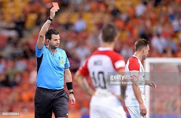 Brendan Santalab of the Wanderers is given a red card from Referee Kris GriffithJones during the round 22 ALeague match between Brisbane Roar and...