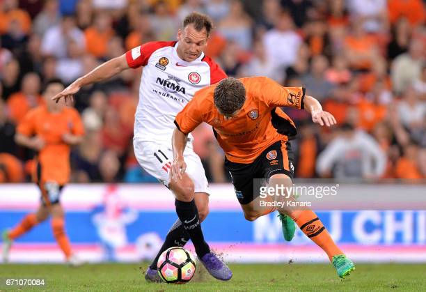 Brendan Santalab of the Wanderers is penalised for this challenge on Thomas Kristensen of the Roar during the ALeague Elimination Final match between...