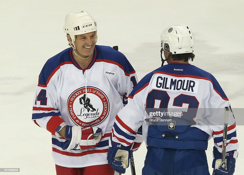 <a gi-track='captionPersonalityLinkClicked' href=/galleries/search?phrase=Brendan+Shanahan&family=editorial&specificpeople=203091 ng-click='$event.stopPropagation()'>Brendan Shanahan</a> chats with <a gi-track='captionPersonalityLinkClicked' href=/galleries/search?phrase=Doug+Gilmour&family=editorial&specificpeople=210813 ng-click='$event.stopPropagation()'>Doug Gilmour</a> during the 2013 Hockey Hall of Fame Legends Classic game at the Mattamy Athletic Center on November 10, 2013 in Toronto, Canada.