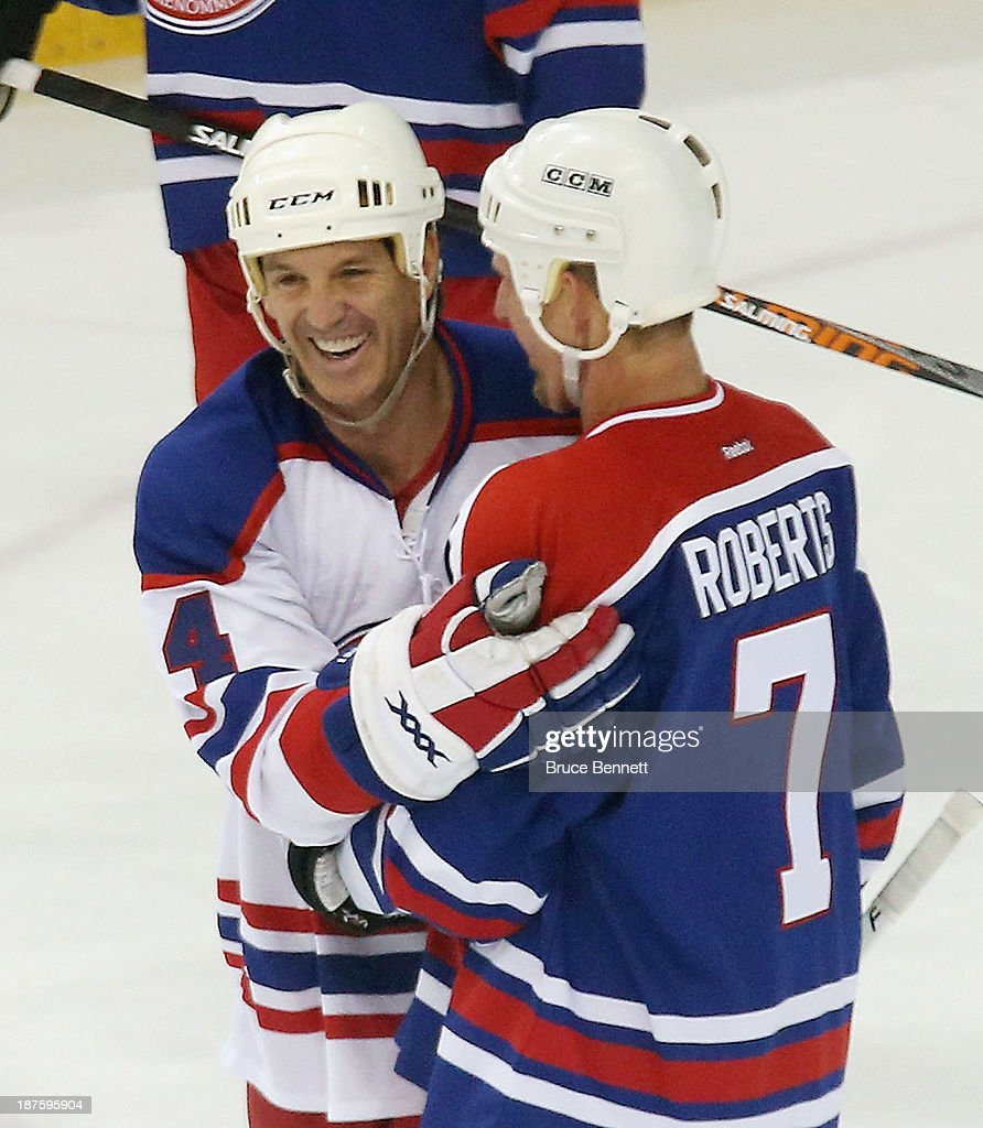 <a gi-track='captionPersonalityLinkClicked' href=/galleries/search?phrase=Brendan+Shanahan&family=editorial&specificpeople=203091 ng-click='$event.stopPropagation()'>Brendan Shanahan</a> is greeted by <a gi-track='captionPersonalityLinkClicked' href=/galleries/search?phrase=Gary+Roberts&family=editorial&specificpeople=202846 ng-click='$event.stopPropagation()'>Gary Roberts</a> during the 2013 Hockey Hall of Fame Legends Classic game at the Mattamy Athletic Center on November 10, 2013 in Toronto, Canada.