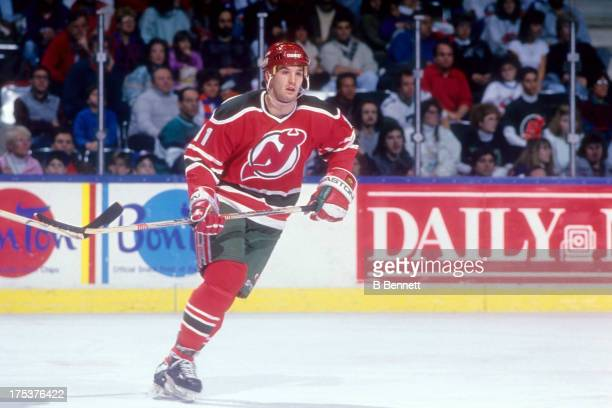 Brendan Shanahan of the New Jersey Devils skates on the ice during an NHL game against the New York Islanders circa 1990 at the Nassau Coliseum in...