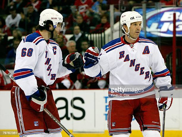 Brendan Shanahan of the New York Rangers celebrates with teammate Jaromir Jagr during a break in NHL game action against the Carolina Hurricanes at...