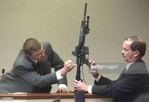 Brendan Shea a DNA expert with the FBI points to the Bushmaster rifle used in the sniper shootings as Prince William County Assistant Commonwealth's...