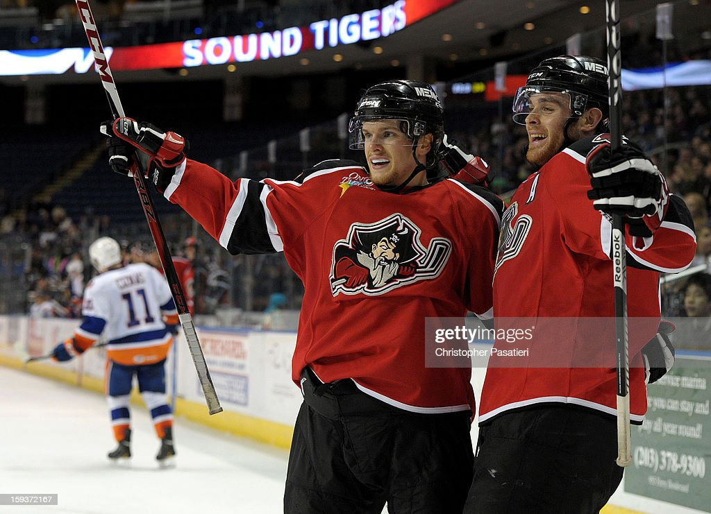 Brendan Shinnimin #16 and Jordan Szwarz #10 of the Portland Pirates celebrate a second period goal during an American Hockey League game against the Bridgeport Sound Tigers on January 12, 2013 at the Webster Bank Arena at Harbor Yard in Bridgeport, Connecticut.