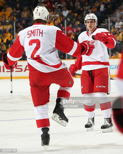 Brendan Smith and Alexei Marchenko of the Detroit Red Wings celebrate a goal against the Nashville Predators during an NHL game at Bridgestone Arena...