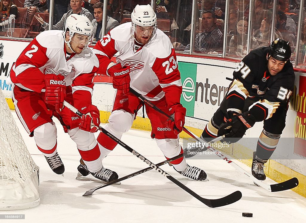 Brendan Smith #2 and Brian Lashoff #23 of the Detroit Red Wings clear the puck from behind the net past <a gi-track='captionPersonalityLinkClicked' href=/galleries/search?phrase=Daniel+Winnik&family=editorial&specificpeople=2529214 ng-click='$event.stopPropagation()'>Daniel Winnik</a> #34 of the Anaheim Ducks on March 24, 2013 at Honda Center in Anaheim, California.