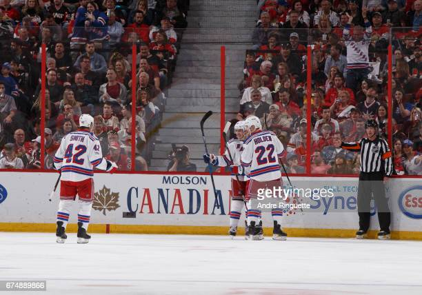 Brendan Smith Jesper Fast and Nick Holden of the New York Rangers celebrate a first period goal against the Ottawa Senators by Michael Grabner in...