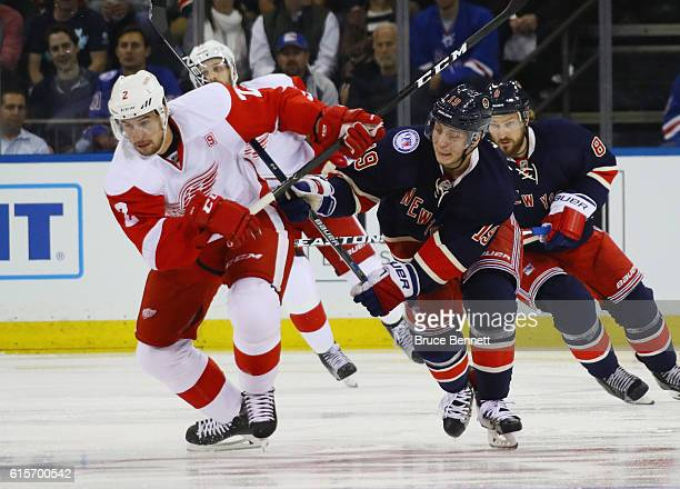 Brendan Smith of the Detroit Red Wings and Jesper Fast of the New York Rangers pursue the puck during the second period at Madison Square Garden on...