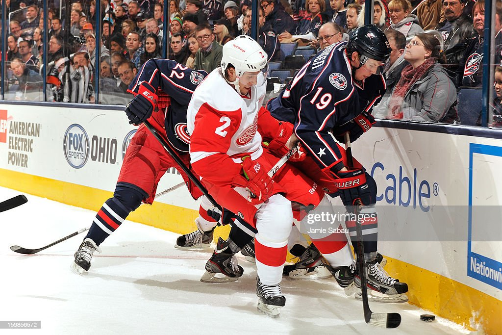 Brendan Smith #2 of the Detroit Red Wings and <a gi-track='captionPersonalityLinkClicked' href=/galleries/search?phrase=Ryan+Johansen&family=editorial&specificpeople=6698841 ng-click='$event.stopPropagation()'>Ryan Johansen</a> #19 of the Columbus Blue Jackets battle for control of the puck in the corner in the third period on January 21, 2013 at Nationwide Arena in Columbus, Ohio. Detroit defeated Columbus 4-3 in a shootout.