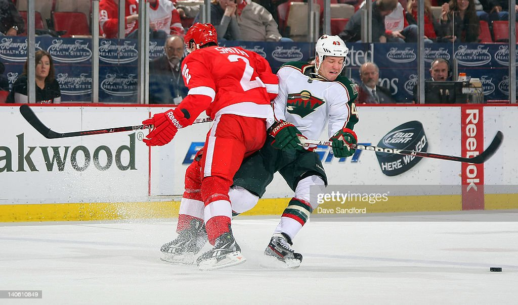 Brendan Smith #2 of the Detroit Red Wings checks <a gi-track='captionPersonalityLinkClicked' href=/galleries/search?phrase=Warren+Peters&family=editorial&specificpeople=2221807 ng-click='$event.stopPropagation()'>Warren Peters</a> #43 of the Minnesota Wild during a NHL game at Joe Louis Arena on March 2, 2012 in Detroit, Michigan.