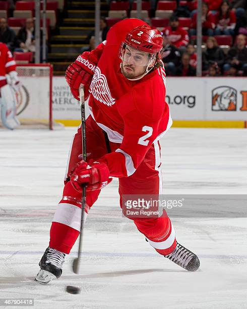 Brendan Smith of the Detroit Red Wings leans into a slap shot during a NHL game against the Tampa Bay Lightning on March 28 2015 at Joe Louis Arena...