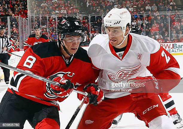 Brendan Smith of the Detroit Red Wings moves in to check Beau Bennett of the New Jersey Devils during the second period at the Prudential Center on...
