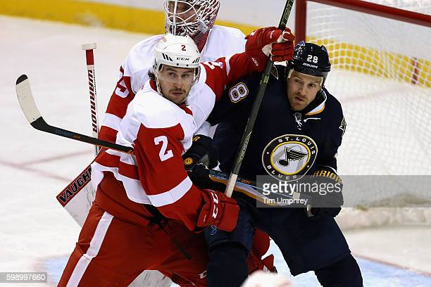 Brendan Smith of the Detroit Red Wings plays against Kyle Brodziak of the St Louis Blues at the Scottrade Center on November 21 2015 in St Louis...
