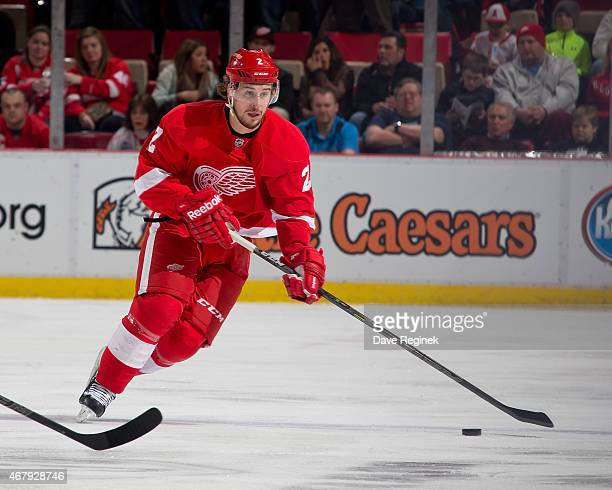 Brendan Smith of the Detroit Red Wings skates up ice with the puck during a NHL game against the San Jose Sharks on March 26 2015 at Joe Louis Arena...