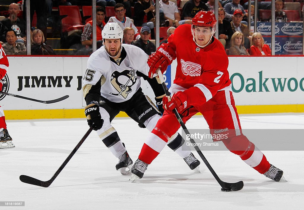 Brendan Smith #2 of the Detroit Red Wings takes a second period shot in front of <a gi-track='captionPersonalityLinkClicked' href=/galleries/search?phrase=Tanner+Glass&family=editorial&specificpeople=4596666 ng-click='$event.stopPropagation()'>Tanner Glass</a> #15 of the Pittsburgh Penguins during a pre season game at Joe Louis Arena on September 25, 2013 in Detroit, Michigan.