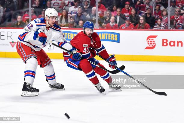 Brendan Smith of the New York Rangers and Paul Byron of the Montreal Canadiens chase the puck in Game Two of the Eastern Conference First Round...