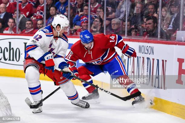 Brendan Smith of the New York Rangers and Tomas Plekanec of the Montreal Canadiens skate after the puck near the boards in Game Five of the Eastern...