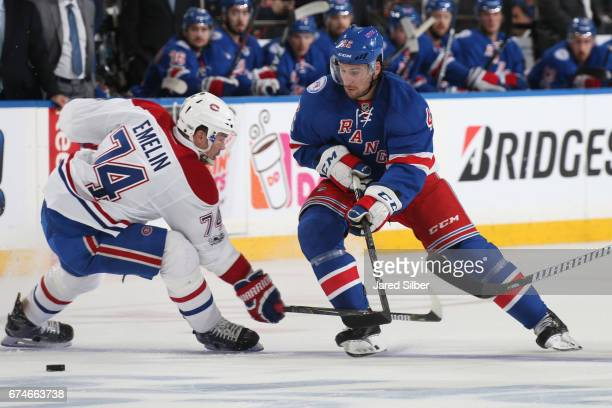 Brendan Smith of the New York Rangers skates for the puck against Alexei Emelin of the Montreal Canadiens in Game Six of the Eastern Conference First...